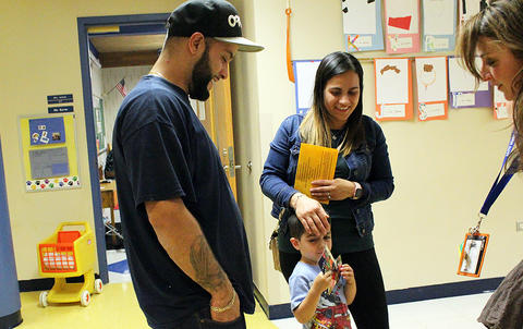 Parents and a student talk with Principal Ms. Joanne Mourikes Rice while attending the Early Childhood Center's Fall 2017 Open House.