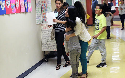 A teacher hugs a student during the Early Childhood Center's Fall 2017 Open House.