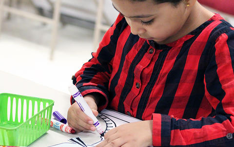 A student does an art activity while attending the Early Childhood Center's Fall 2017 Open House.