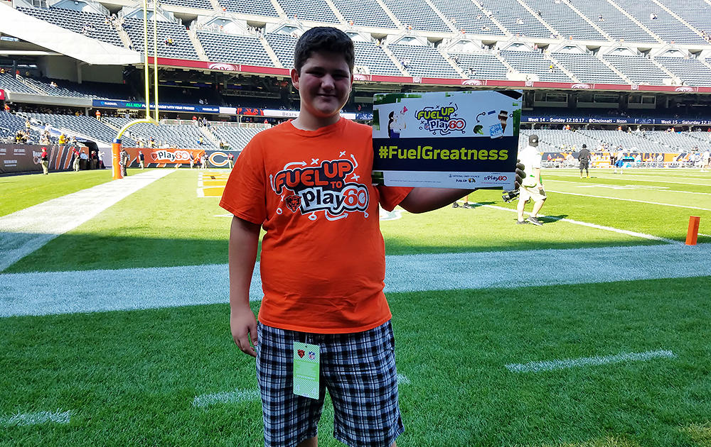 Nathan Calderon displays the Fuel Up to Play 60 hashtag.