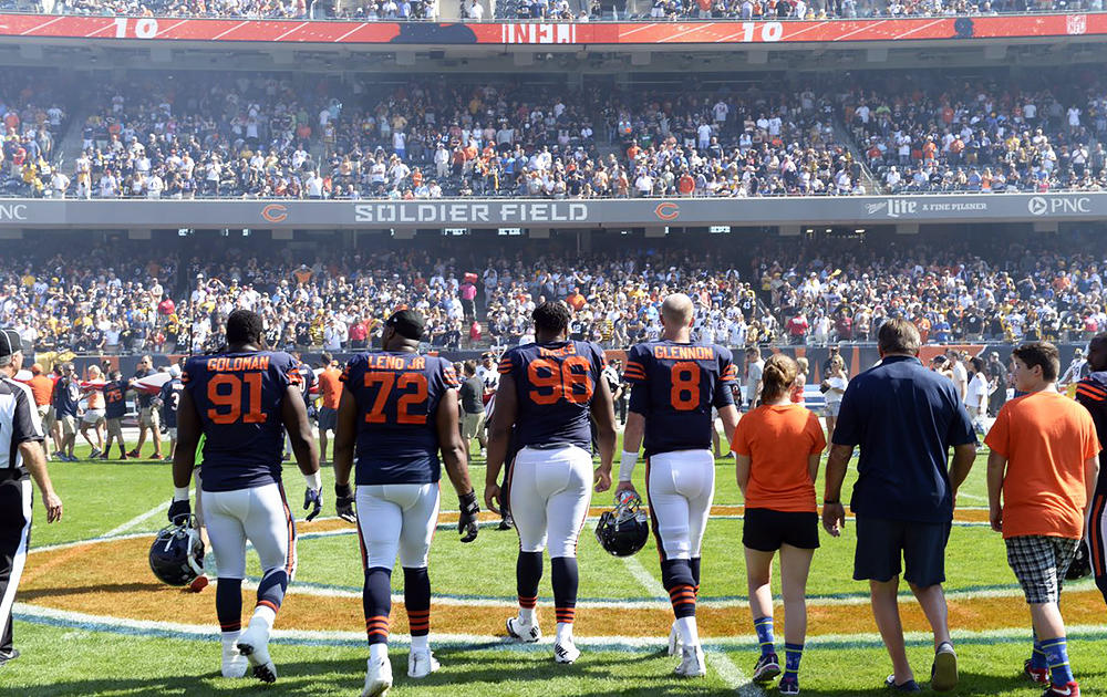 Elm 8th-grader Nathan Calderon walks onto Soldier Field with members of the Chicago Bears prior to the start of the Bears' Sept. 24 game against the Pittsburgh Steelers.