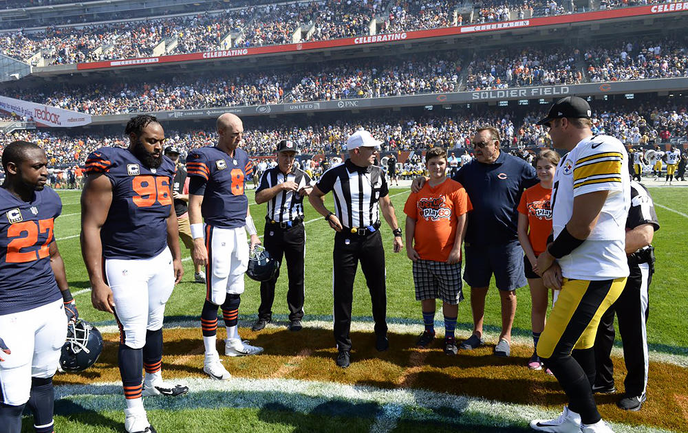 Elm 8th-grader Nathan Calderon stands at midfield to watch the coin toss between the Chicago Bears and Pittsburgh Steelers.