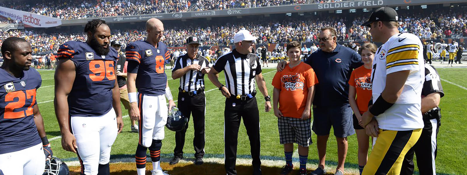 Elm 8th grader Nathan Calderon joins the Bears and Steelers at midfield for the pregame coin toss at Soldier Field.