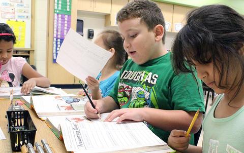 Students read out loud in Ms. Sandra Katsantones' 2nd-grade class.
