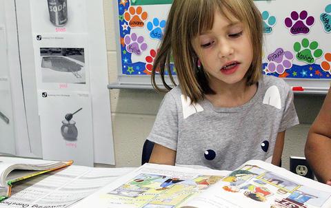 A student reads out loud in Ms. Sandra Katsantones' 2nd-grade class.
