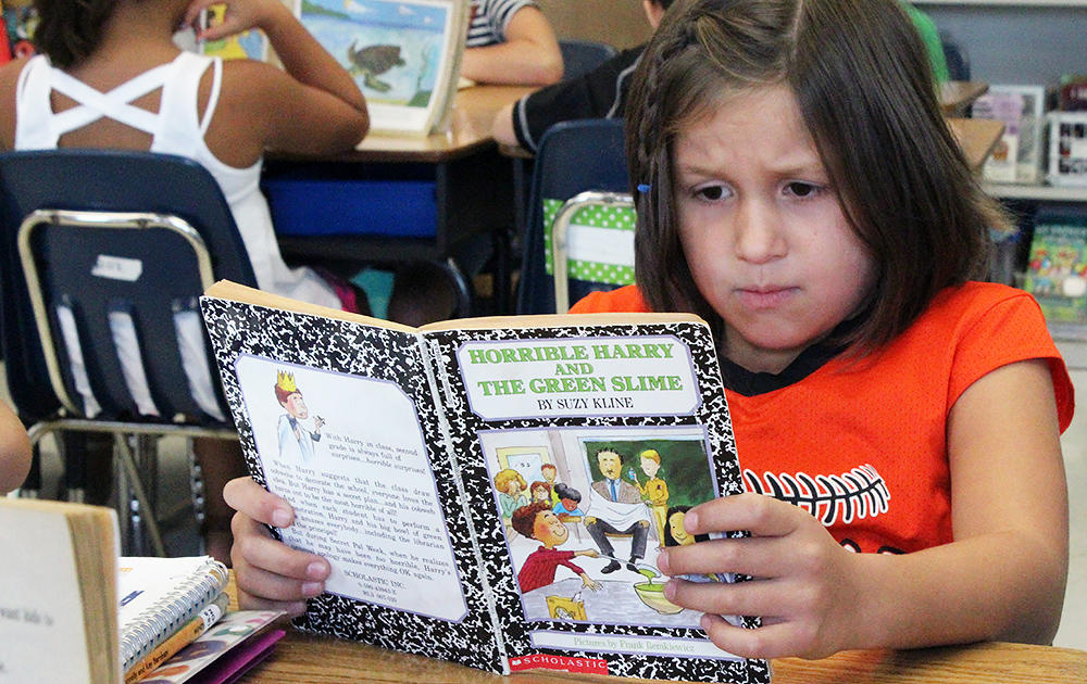 An Elmwood 3rd grader reads silently during class.