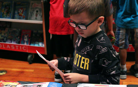 A John Mills Elementary School student browses the selections at the PTA's Fall 2017 Scholastic Book Fair.