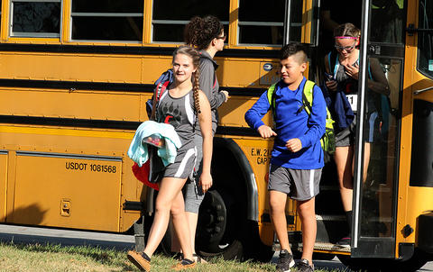 Elm arrives at Schiller Woods East for the Leyden-Norwood Athletic Conference cross country tournament.