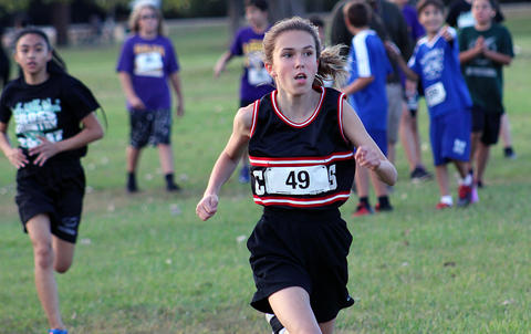 An Elm runner heads to the finish line.