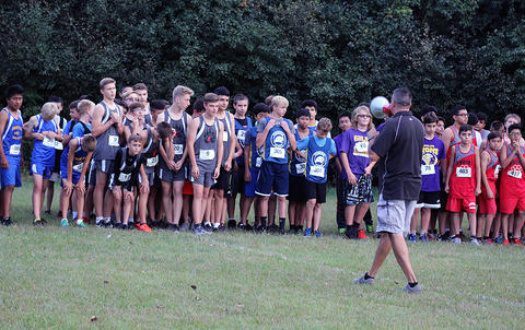 Runners receive instructions from Mr. Bob Biedke, conference director
