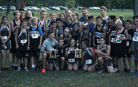 The Elm cross country teams display their second-place conference trophies.