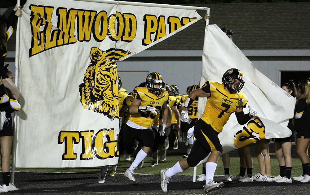 The EPHS Tigers run onto the field before the start of their homecoming game against Ridgewood.