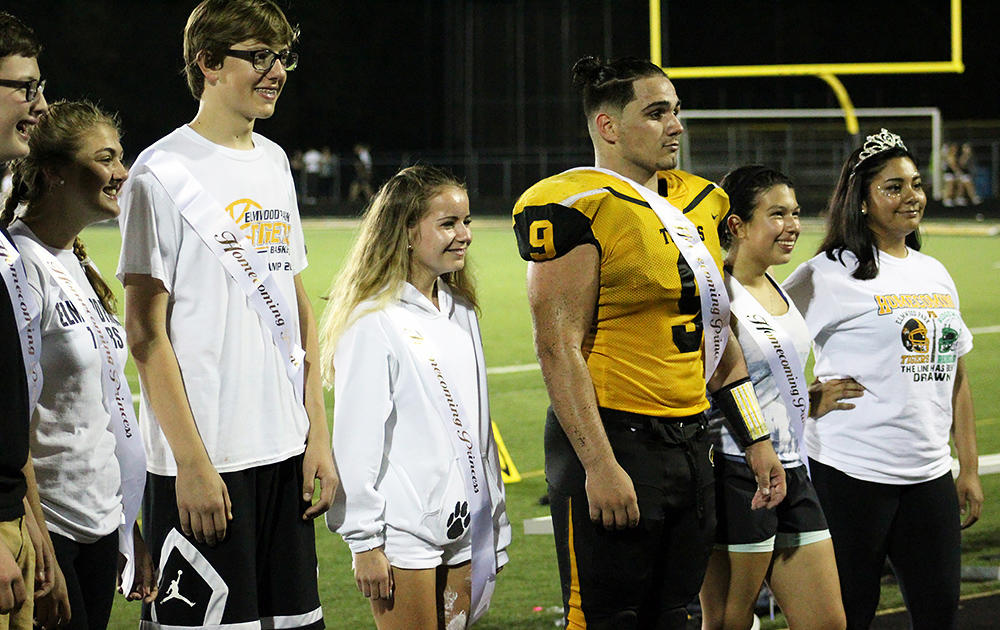Luciano Martino takes his place on the Homecoming Court as homecoming prince.