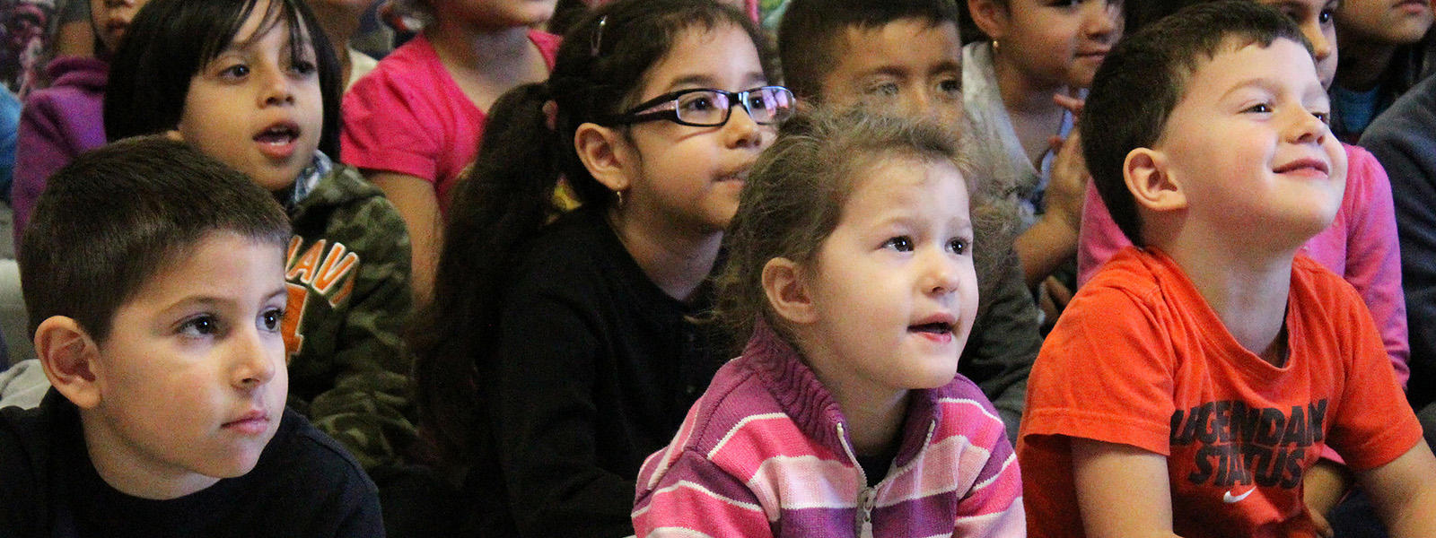 ECC students watch Dave Herzog's marionette show.