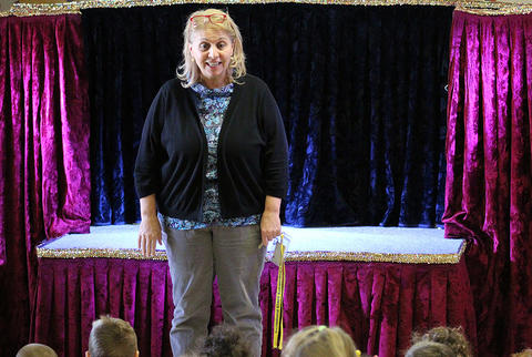 ECC Principal Joanne Mourikes Rice introduces puppeteer Dave Herzog before one of his Nov. 20 shows at the school.