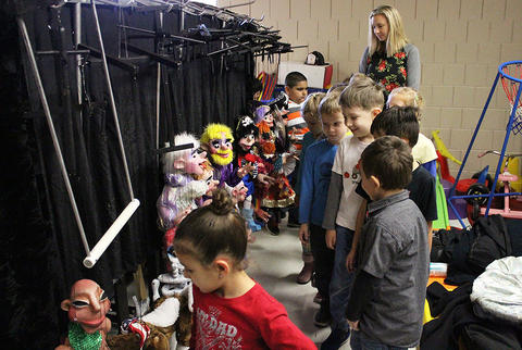 ECC students tour backstage after one of Dave Herzog's marionette shows at the school.