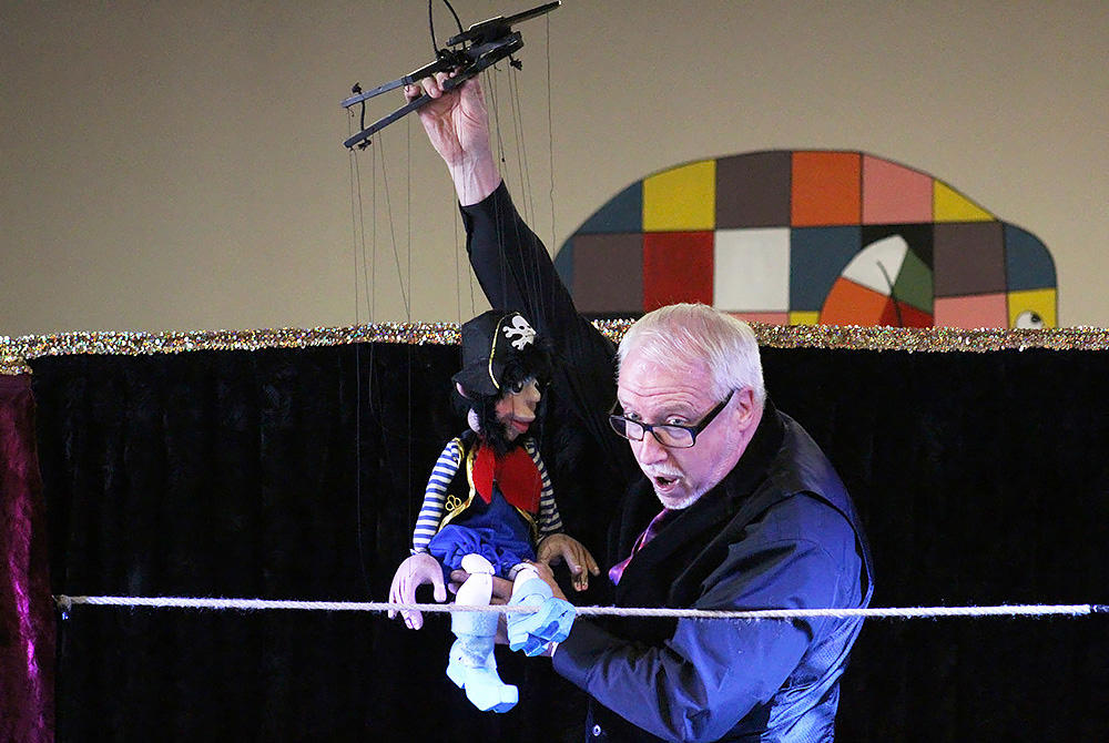 Puppeteer Dave Herzog manipulates one of his marionettes during a show at the ECC in November 2017.