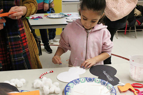 Students and parents participate in the ECC's Winter Crafts Family Event.