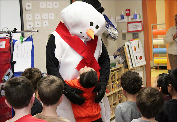 Frosty the Snowman visits the ECC as students get into the holiday spirit