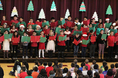 Members of the John Mills Choir perform at the school's 2017 Winter Concert.