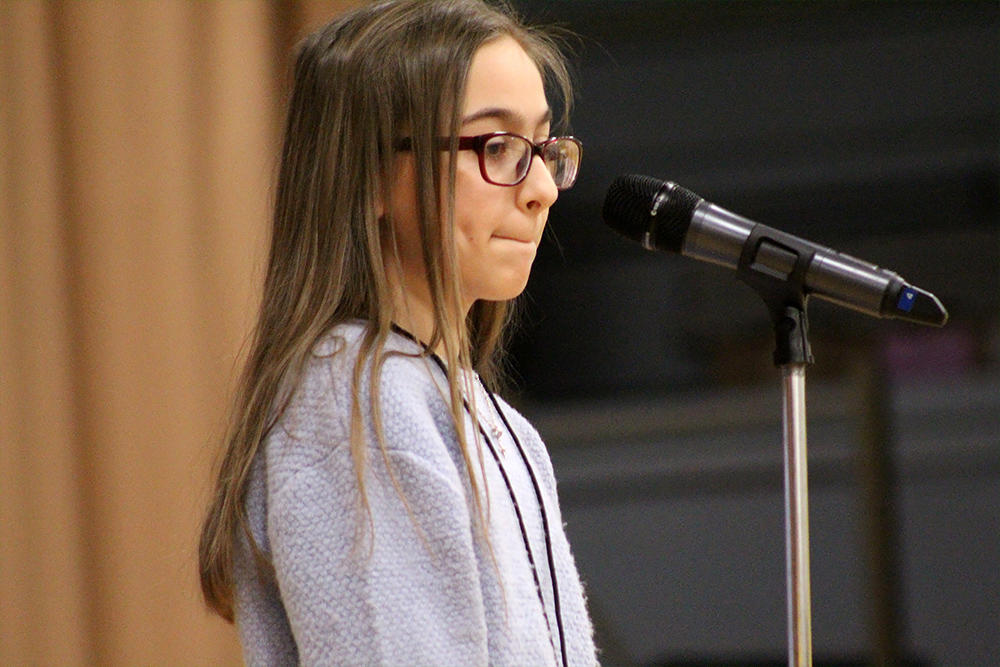 Anastasia Prodanchuk waits for her next word during the 2018 District Spelling Bee. She finished as runner-up to three-time District spelling champion Andrew Ticao of John Mills.