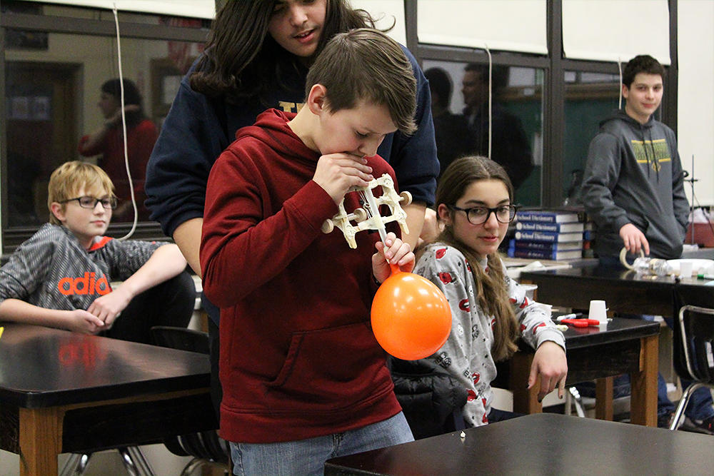 Elm students build a balloon car.