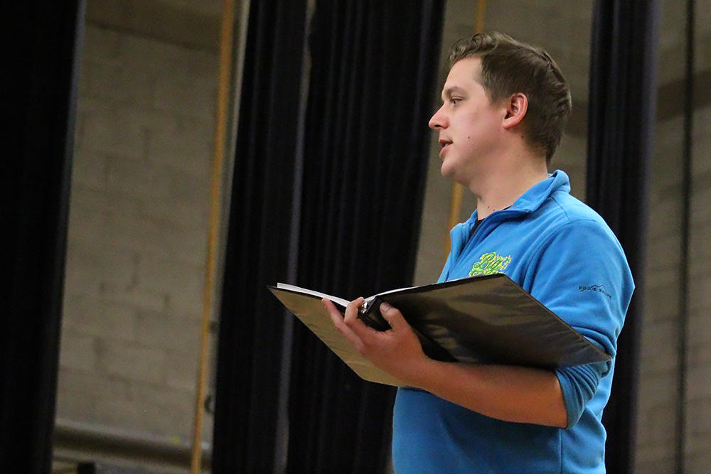 "Noah Pligge directs a rehearsal of ""Cinderella"""