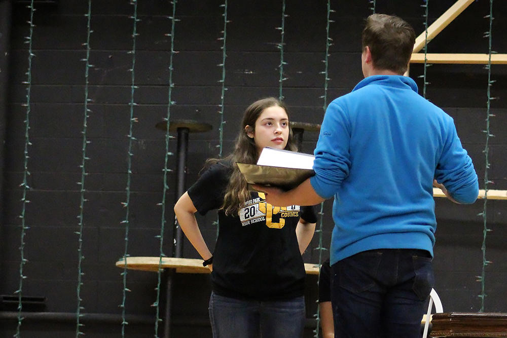 Noah Pligge gives instructions to Elizabeth Goranson, who plays the title role of Ella in the EPHS spring musical.