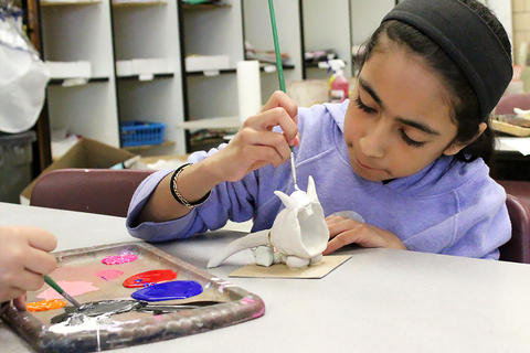 John Mills students prepare artwork for the school's upcoming art show.