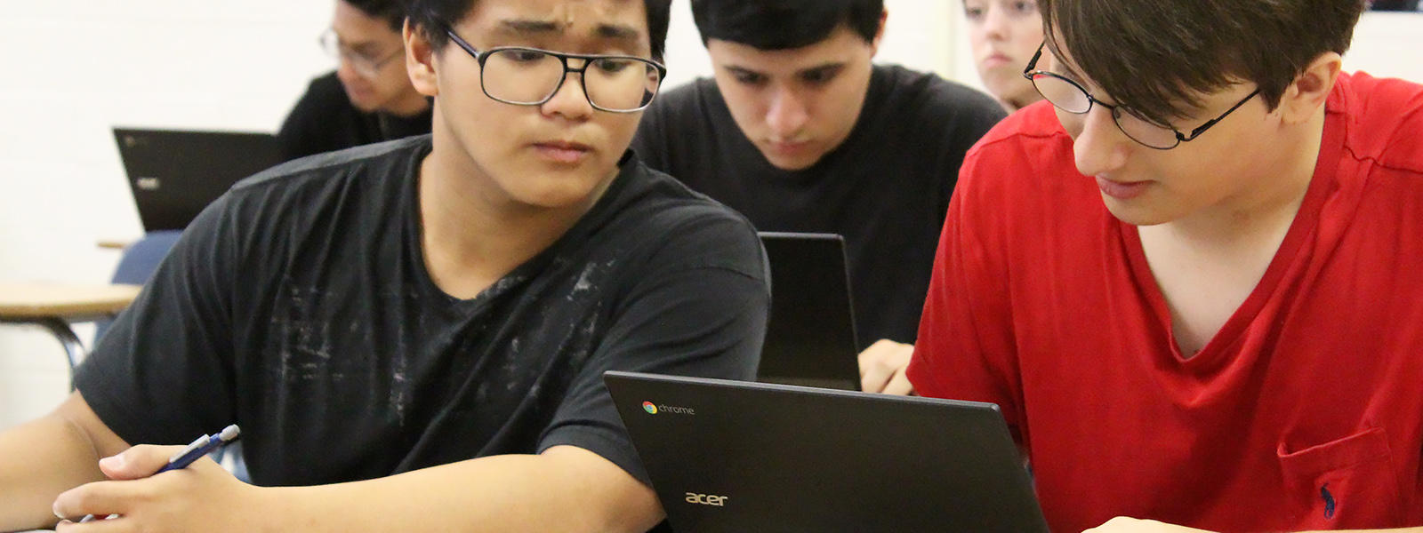 EPHS students use their laptops in class.
