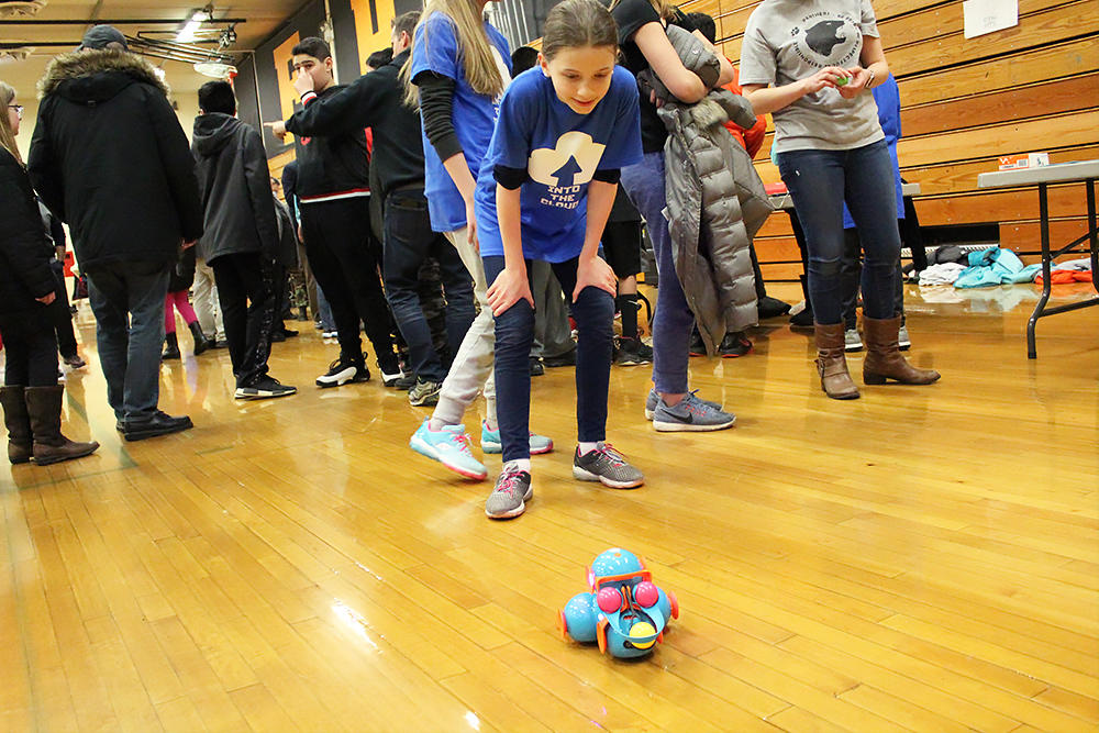 An Elmwood student watches a robot at work.