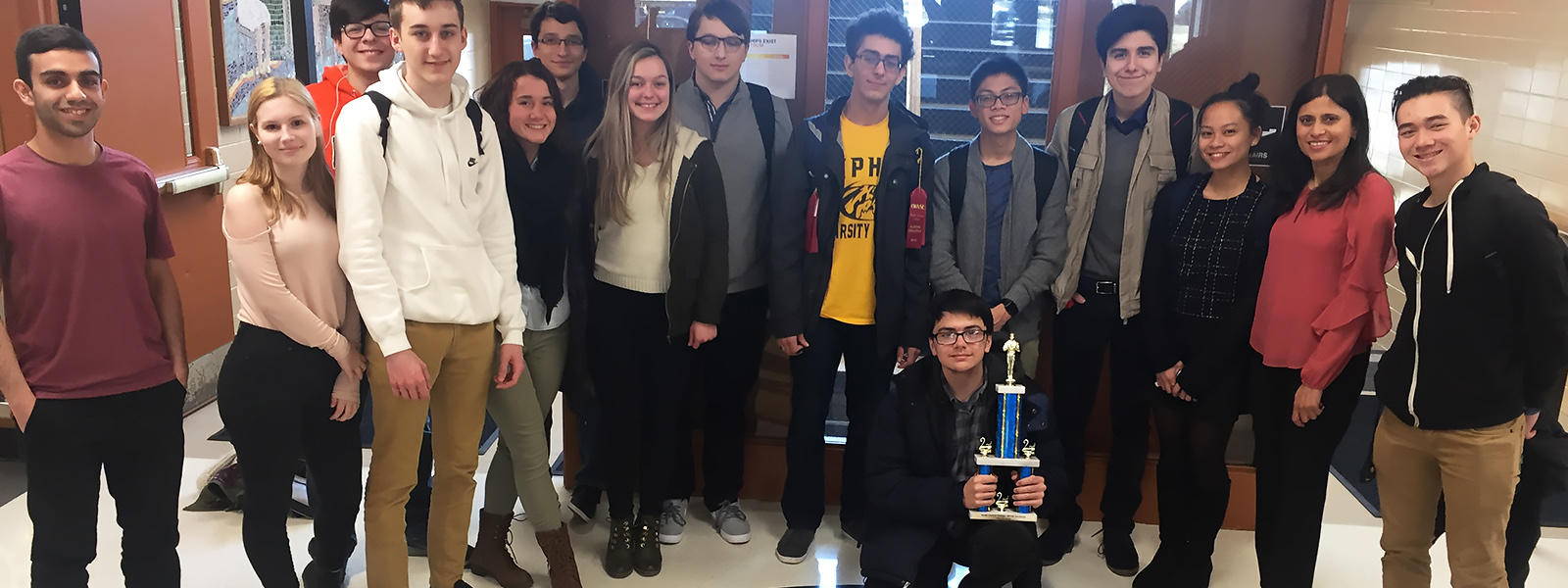 WYSE team members display their sectional runner-up trophy.
