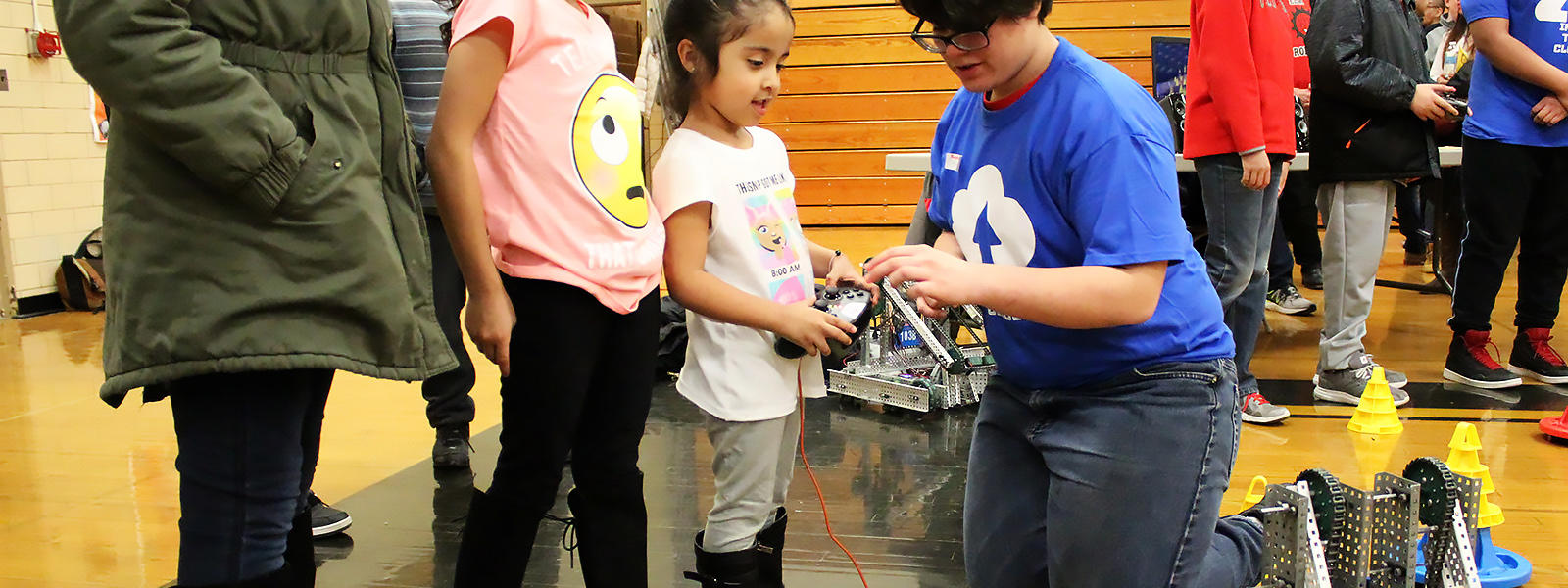 "A student commands a robot during ""Into the Cloud."""