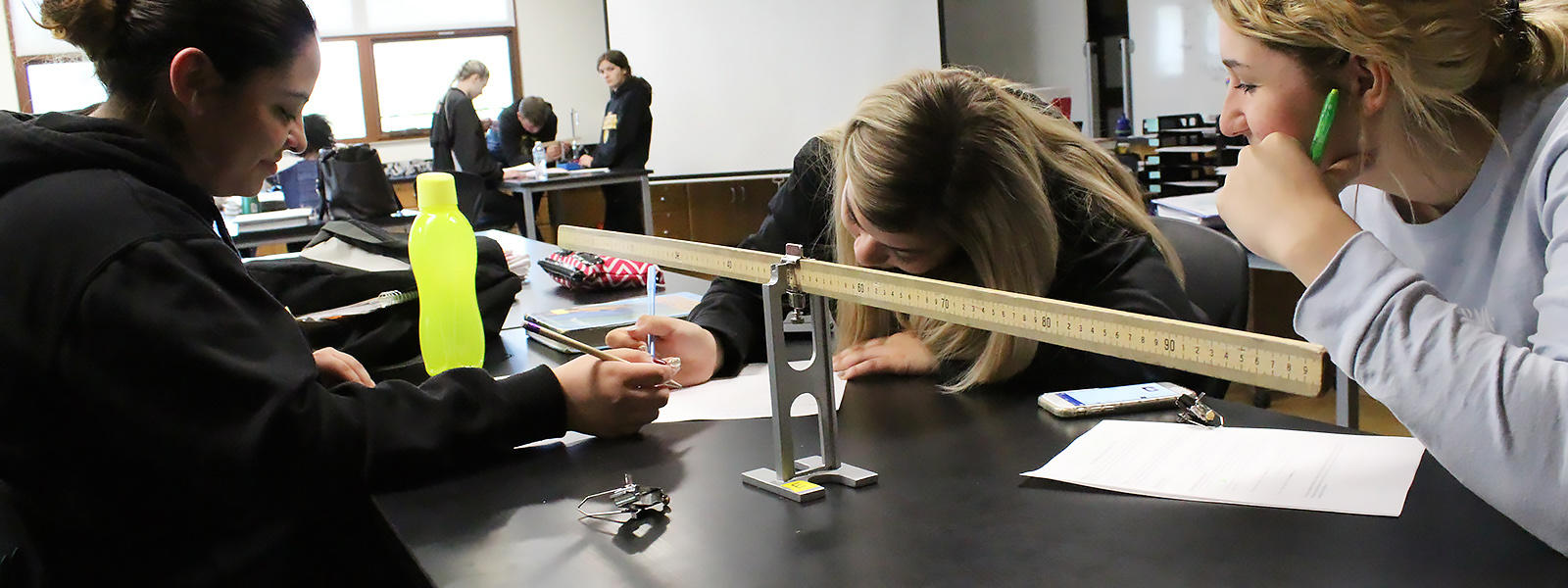 EPHS students work on a science assignment.