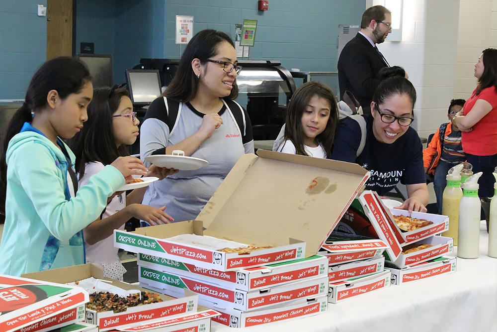 Parents and students enjoy pizza at the May 23 Elmwood meet and greet.