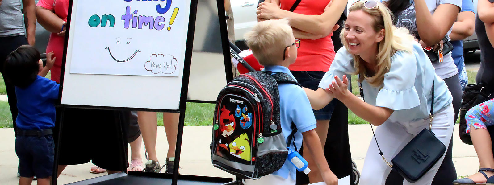 ECC students and parents reunite after the first day of school.