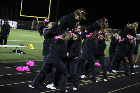 Homecoming Game: Varsity Cheerleaders Before Kickoff