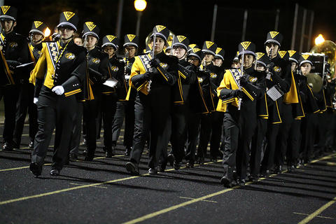 Homecoming Game: Marching Tigers Enter the Stadium