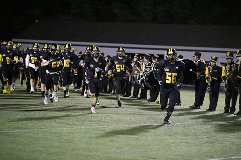 Homecoming Game: Varsity Players Take the Field vs. Longwood
