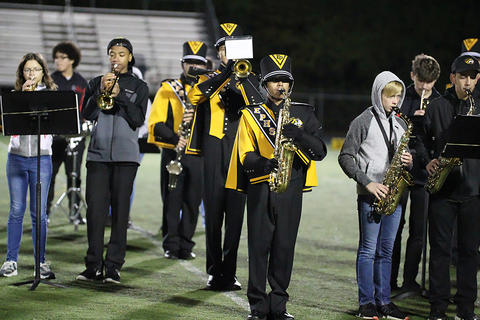 Homecoming Game: Marching Tigers at Halftime with Elm Middle School Band Members