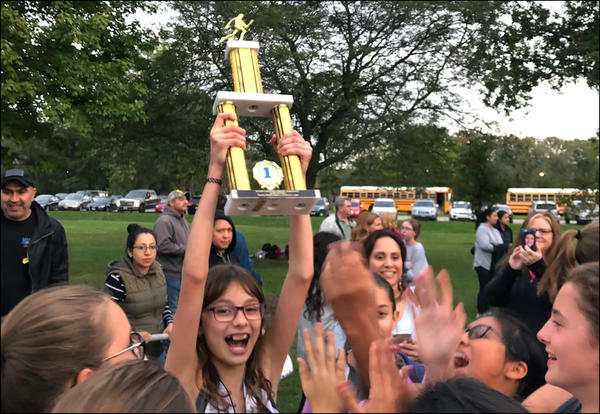 The Elm girls cross country team celebrates winning the 2018 LNAC title.
