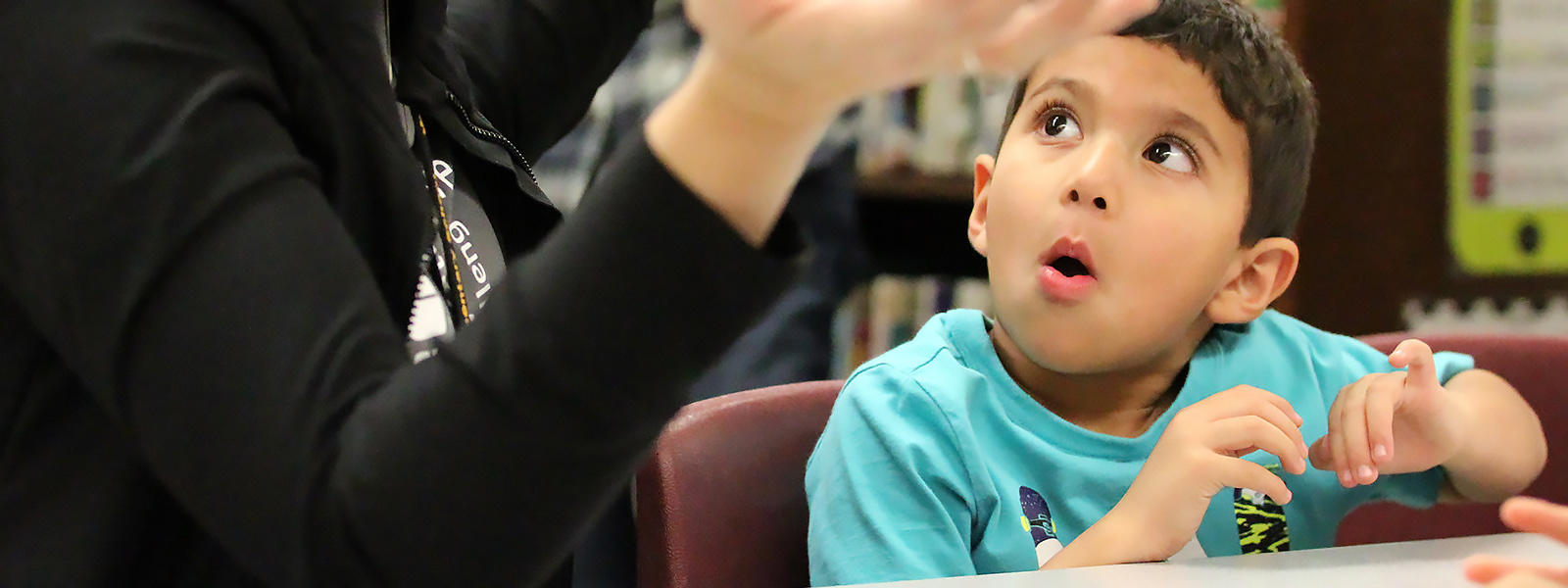An ECC student reacts to a teacher's presentation at the 2018 STEMrangers Family Event.