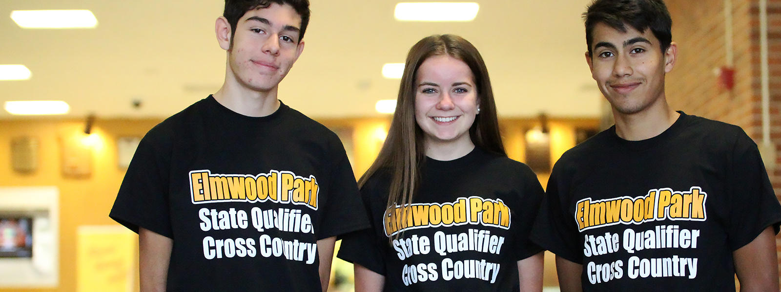 Cross country state qualifiers Khris Vicencio (left), Gabi Szado and Carlos Sanchez gather for a group photo before leaving for the IHSA cross country state finals in Peoria.