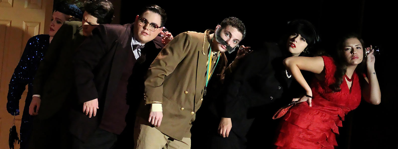 "The cast of ""Clue: On Stage"" performs a scene from the 2018 EPHS Fall Play."