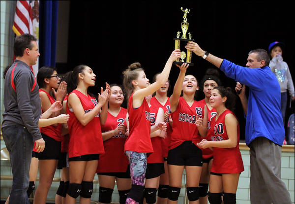 Elm 7th-grade volleyball players celebrate the end of a successful season.