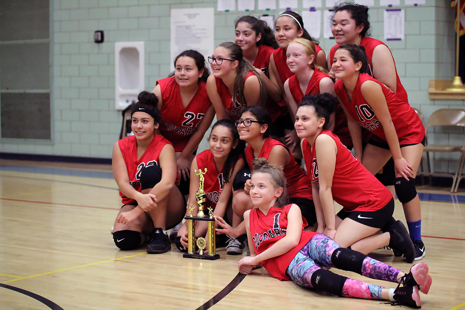 Elm 7th graders pose with their team trophy.