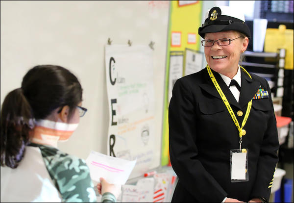 An Elmwood Elementary School student thanks Navy veteran Amy Cleff-Holic for her service.