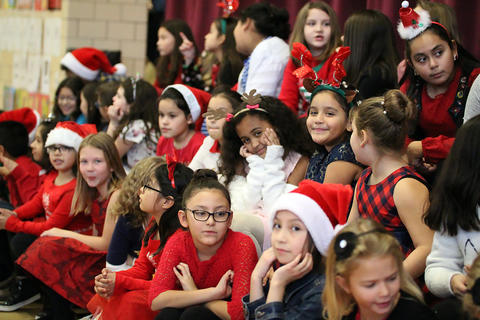 John Mills Choir members perform during the school's 2018 Winter Concert.