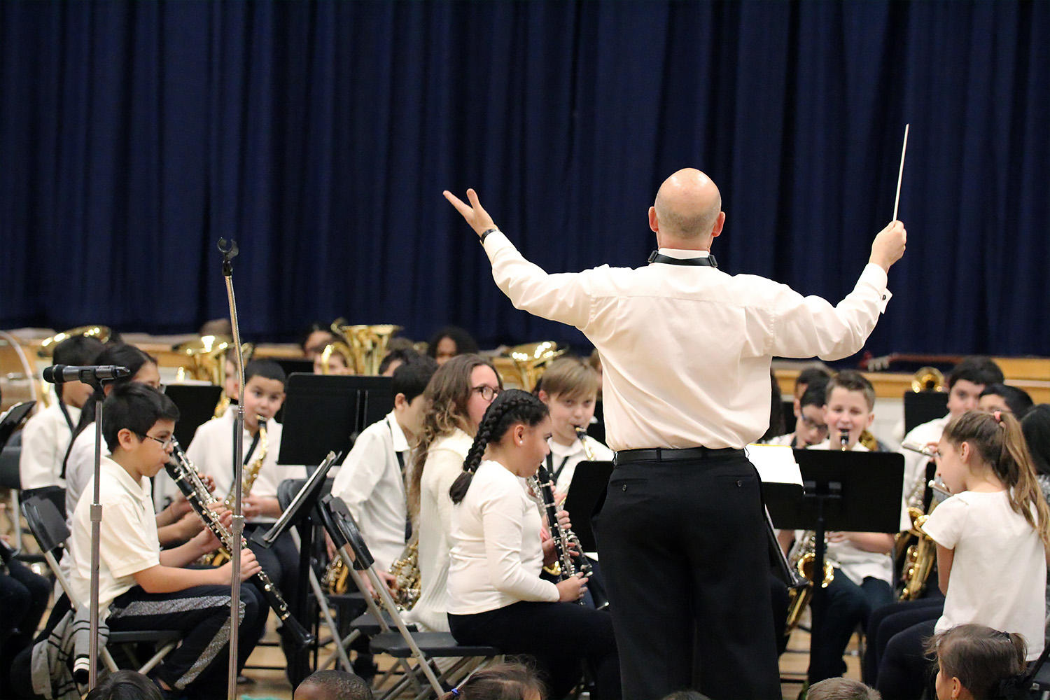 "Mr. Stephen Hawk leads the Elmwood School Band members as they perform during ""Sounds of the Season,"" the school's 2018 Winter Concert."