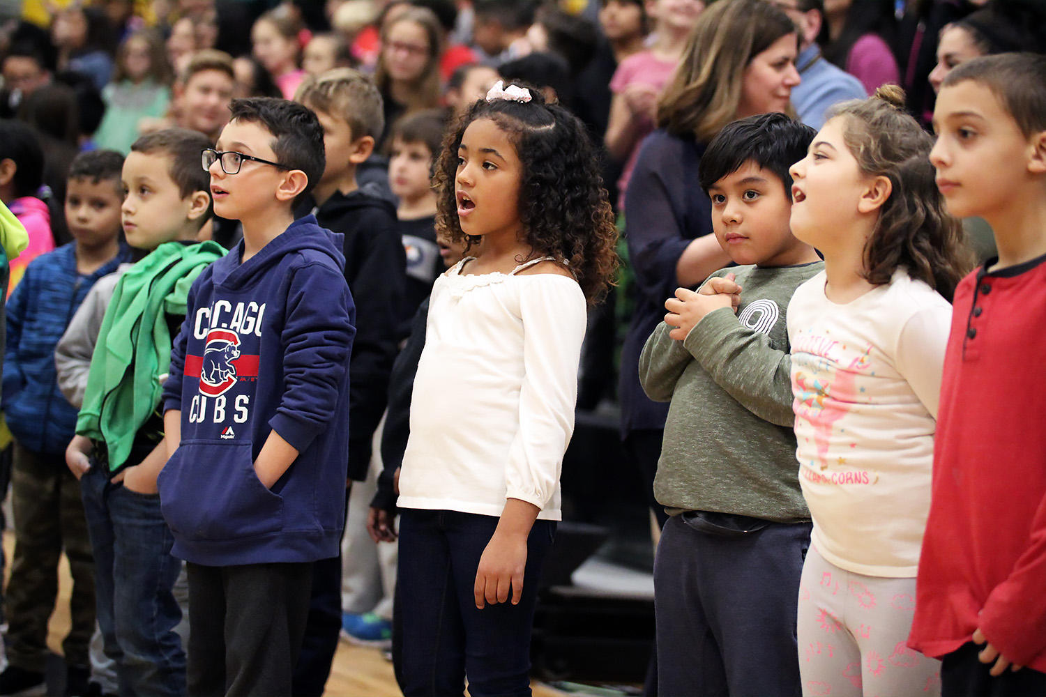 Elmwood students join the holiday sing-along at the conclusion of the 2018 Winter Concert.